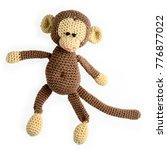 amigurumi crocheted monkey toy...   Shutterstock . vector #776877022