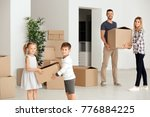 happy family unpacking things... | Shutterstock . vector #776884225