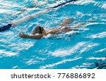 boy on a swim in a sports pool   Shutterstock . vector #776886892