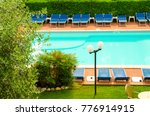 Pool With Chaise Longues In...