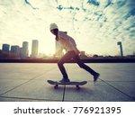 female skateboarder riding with ... | Shutterstock . vector #776921395