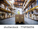 male warehouse worker pulling a ... | Shutterstock . vector #776936056