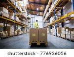 Male Warehouse Worker Pulling ...
