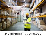 man with drone in a warehouse. | Shutterstock . vector #776936086