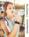 young woman drinking water... | Shutterstock . vector #776950756