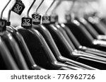 Small photo of hanger with size showing size 32. lifestyle concept. (selective focus black and white image )