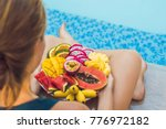young woman relaxing and eating ... | Shutterstock . vector #776972182