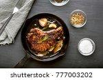 fried pork steak in frying pan... | Shutterstock . vector #777003202