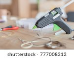 table with tools for handmade accessories manufactoring