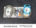 Small photo of Handcuffs, money and alarm clock on dark background, bail concept