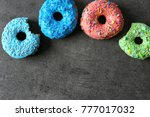 fresh yummy colorful donuts on... | Shutterstock . vector #777017032