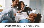 happy family watching... | Shutterstock . vector #777018148