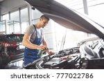 auto mechanic working in garage.... | Shutterstock . vector #777022786