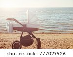 one pram baby on beach by the... | Shutterstock . vector #777029926
