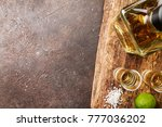 tequila shot with lime | Shutterstock . vector #777036202