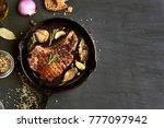 grilled pork steak in frying... | Shutterstock . vector #777097942