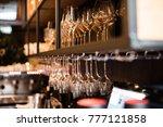 wine glasses in warm light loft ... | Shutterstock . vector #777121858