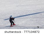 "Small photo of ""Gornaya Salanga"", Russian Federation - February 22, 2017.Children skiing in the mountains. Active kid with a protective helmet, glasses and pillars. A lesson for children in an alpine school."