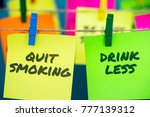 Small photo of A set of colorful sticky notes with positive affirmation words and phrases hung from a clothesline by clothespins; featuring Quit Smoking and Drink Less.