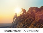 Small photo of People helping each other hike up