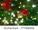 Small photo of Green christmas tree in unfocus. Abstract background