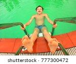teen boy in swimming pool close ... | Shutterstock . vector #777300472