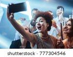 group of friends taking selfies ... | Shutterstock . vector #777304546