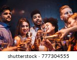 group of friends celebrating... | Shutterstock . vector #777304555