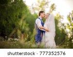 wedding couple kissing in park... | Shutterstock . vector #777352576