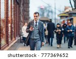 young man using the phone while ... | Shutterstock . vector #777369652