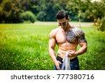 handsome muscular shirtless... | Shutterstock . vector #777380716