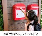 asian kid sending her mail in... | Shutterstock . vector #777386122