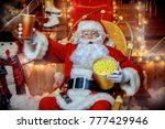 santa claus sitting on his... | Shutterstock . vector #777429946