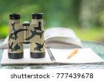 bird watcher and bird watching... | Shutterstock . vector #777439678