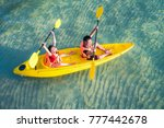 Asian Kid To Play Kayak On The...