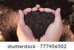 soil in farmer hand | Shutterstock . vector #777456502
