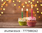 Small photo of cupcakes on dark old wooden background