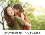 girl kissing mother when she... | Shutterstock . vector #777593266