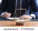 scales of justice on table in
