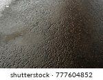 Small photo of Wet asphalt. Wet asphalt background. Wet asphalt texture. Grunge pavement.