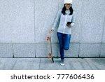 female skateboarder using... | Shutterstock . vector #777606436