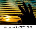hand opens the blinds....   Shutterstock . vector #777616822