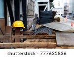 a construction worker is... | Shutterstock . vector #777635836