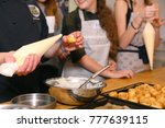 profiterols cooking lesson with ... | Shutterstock . vector #777639115