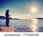 Fisherman Check Pushing Bait O...