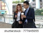 businessman and businesswoman... | Shutterstock . vector #777645055