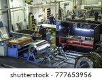 industrial workshop or hangar... | Shutterstock . vector #777653956