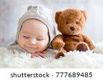 sweet baby boy in bear overall  ...   Shutterstock . vector #777689485