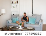 happy young blonde man sitting... | Shutterstock . vector #777690382