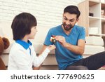 father has fun with his son. an ... | Shutterstock . vector #777690625